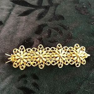 Vintage hair clip in gold tone
